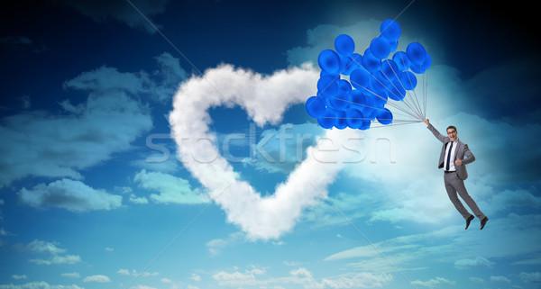 Man flying balloons in romantic concept Stock photo © Elnur