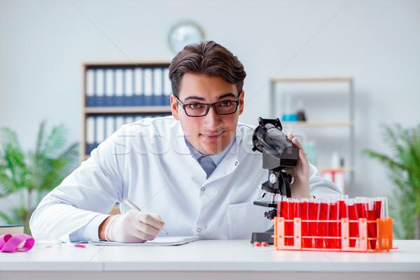 Fiatal orvos dolgozik labor mikroszkóp diák Stock fotó © Elnur