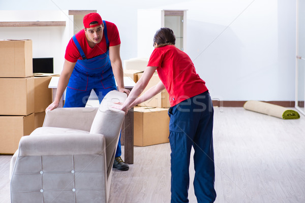 Professional movers doing home relocation Stock photo © Elnur
