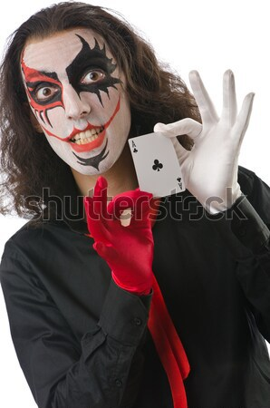 Evil clown with cards in dark room Stock photo © Elnur