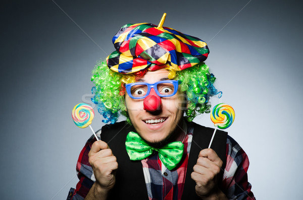 Funny clown with sweet lollipop Stock photo © Elnur