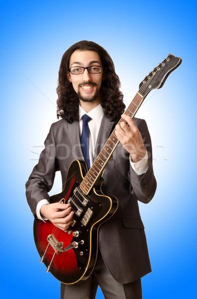Guitarrista negócio terno branco festa metal Foto stock © Elnur