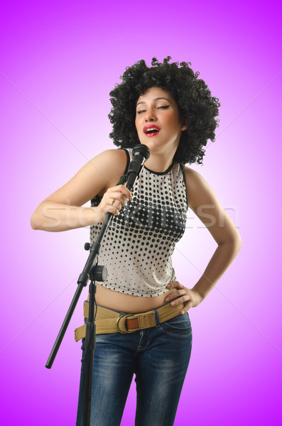 Woman with afro haircut on white Stock photo © Elnur