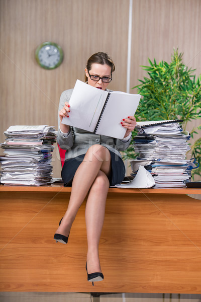Businesswoman under stress working in the office Stock photo © Elnur