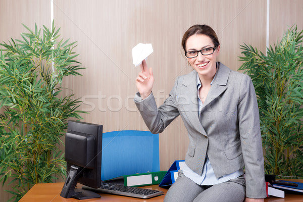 The office woman making paper airplanes Stock photo © Elnur