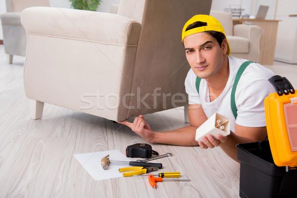 Furniture repairman repairing armchair at home Stock photo © Elnur