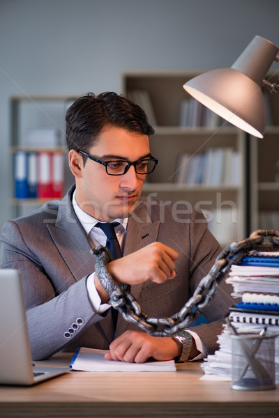 Businessman staying in the office for long hours Stock photo © Elnur