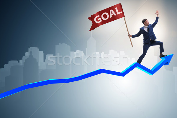 Businessman achieving his business goals and targets Stock photo © Elnur