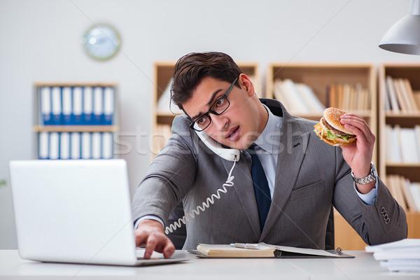 Aç komik işadamı yeme sandviç Stok fotoğraf © Elnur