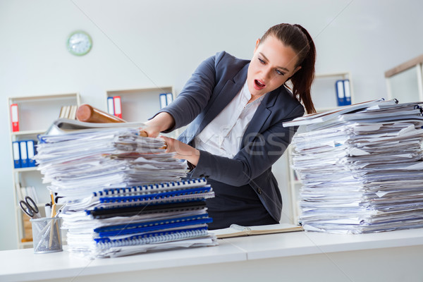 Angry businesswoman with baseball bat in office Stock photo © Elnur