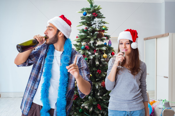The happy boyfriend and girlfriend drinking champagne on christmas  Stock photo © Elnur