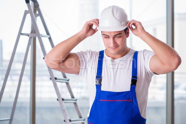 Young worker with safety helmet hardhat Stock photo © Elnur