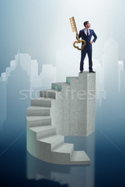 Businessman with key to success at the top of career  Stock photo © Elnur
