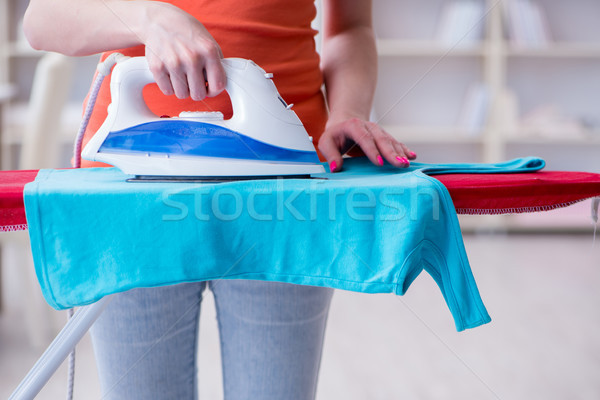 Woman wife doing ironing at home Stock photo © Elnur