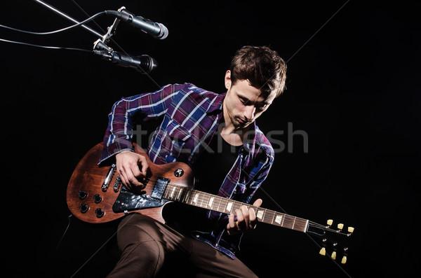 Homme jouer guitare concert musique fête Photo stock © Elnur