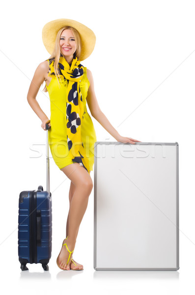 Woman preparing for vacation with suitcase and blank  board isol Stock photo © Elnur