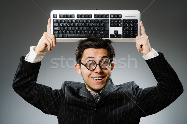 Comouter geek with computer keyboard Stock photo © Elnur