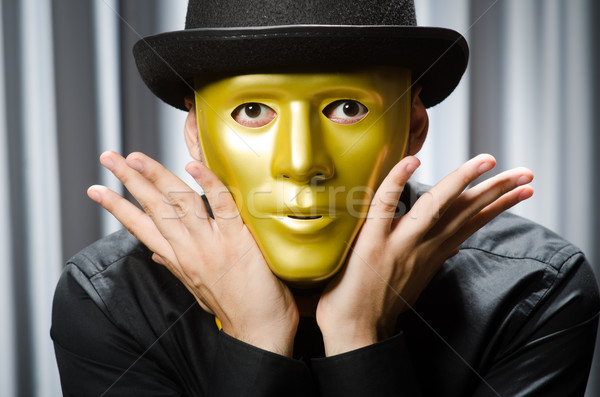 Funny concept with theatrical mask Stock photo © Elnur