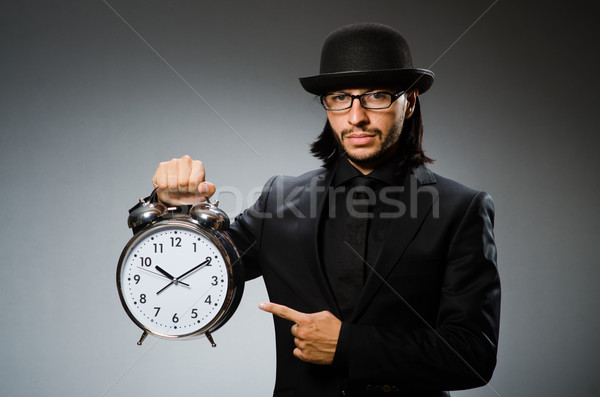 Man with clock wearing vintage hat Stock photo © Elnur