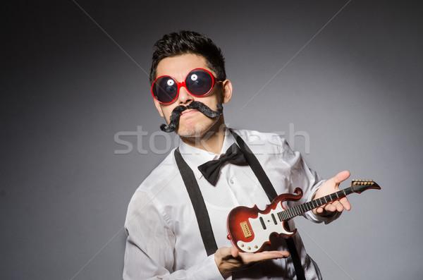 Vicces férfi mini gitár buli háttér Stock fotó © Elnur