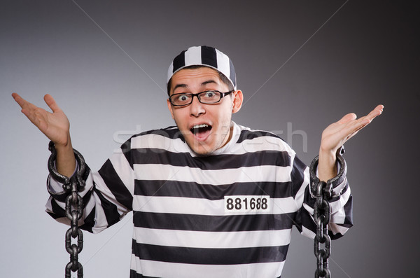Funny prisoner in chains isolated on gray Stock photo © Elnur