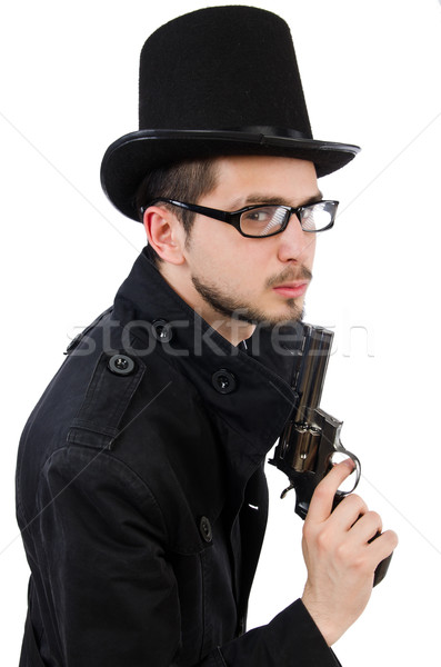 Young detective in black coat holding handgun isolated on white Stock photo © Elnur