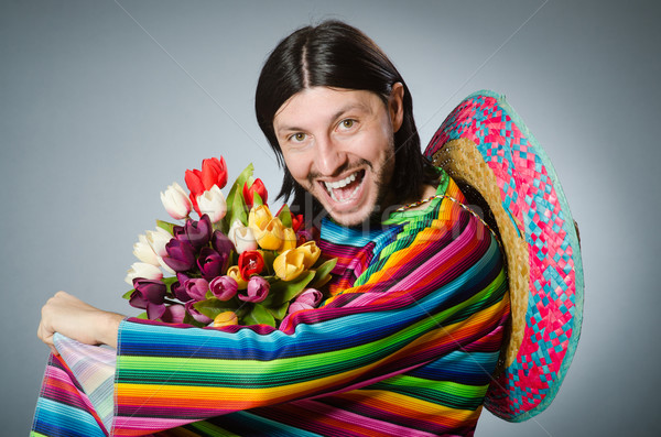 Stock photo: Mexican man with tulip flowers