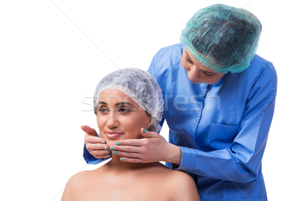 Young woman preparing for plastic surgery isolated on white Stock photo © Elnur