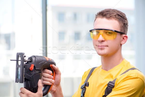 Zdjęcia stock: Młodych · pracownik · budowlany · żółty · strony · budynku · drewna