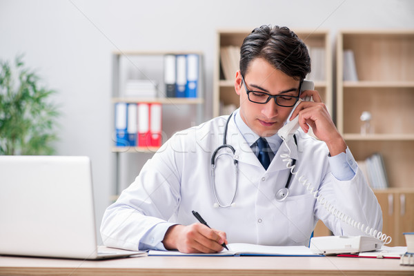 The doctor consulting patient over the phone Stock photo © Elnur