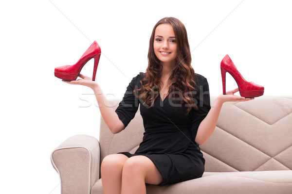 The woman having difficult choice between shoes Stock photo © Elnur