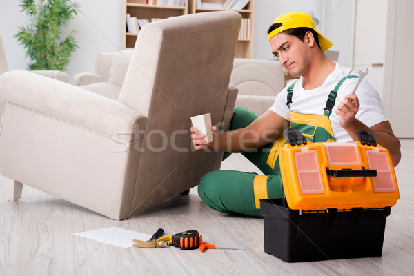 Furniture repairman repairing armchair at home Stock photo © Elnur