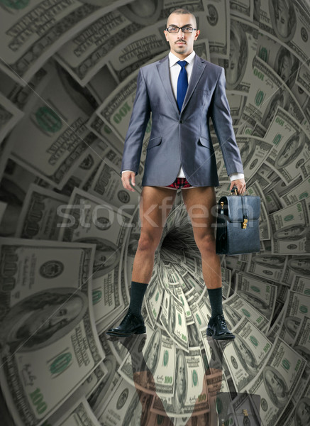 Businessman fighting against dollar funnel Stock photo © Elnur
