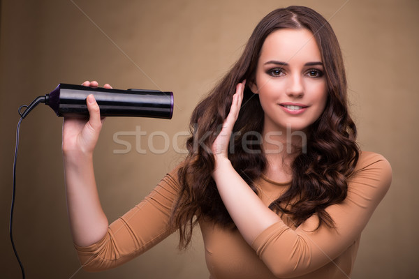 Beautiful woman with hair dryer Stock photo © Elnur