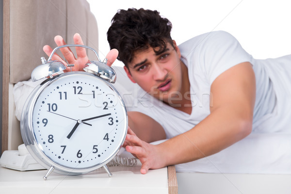 Man in bed suffering from insomnia Stock photo © Elnur