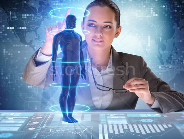 The futuristic remote diagnostics concept with businesswoman Stock photo © Elnur