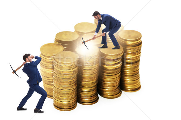 Cryptocurrency concept with businessman mining money Stock photo © Elnur