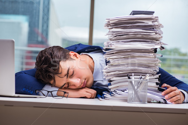 Businessman with pile stack of paper paperwork in the office Stock photo © Elnur