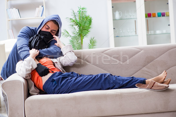 The armed man assaulting young woman at home Stock photo © Elnur