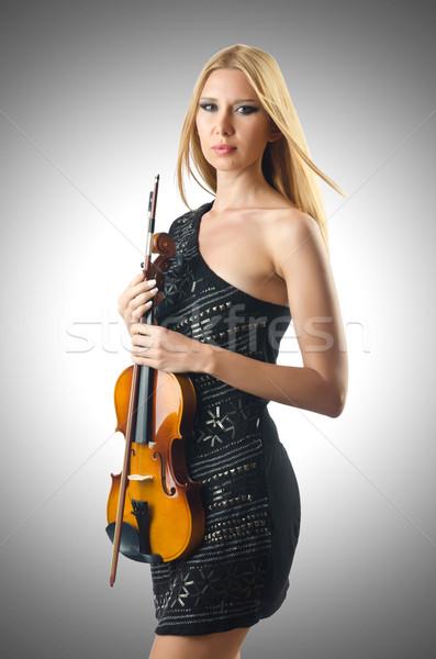 Woman playing violin on white Stock photo © Elnur