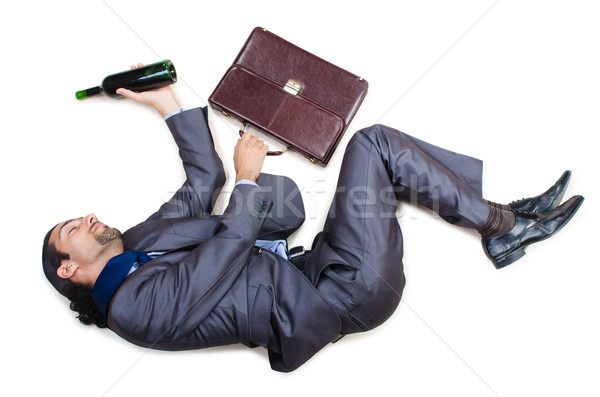 Businessman on the floor isolated on white Stock photo © Elnur
