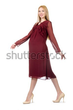 Pretty pregnant woman in red dress isolated on white Stock photo © Elnur