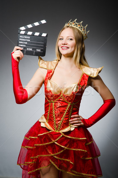 Queen in red dress with movie clapboard Stock photo © Elnur