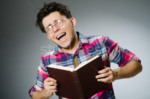 Grappig student veel boeken man achtergrond Stockfoto © Elnur
