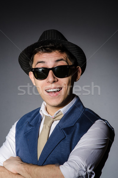 Young man in blue vest and hat against gray Stock photo © Elnur