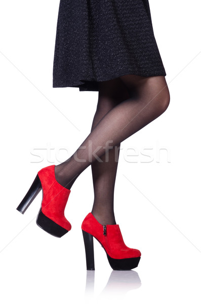 Woman legs with red shoes isolated on the white Stock photo © Elnur
