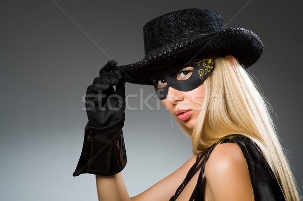 Woman wearing mask against dark background Stock photo © Elnur
