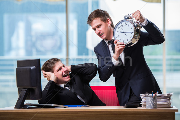 Two twins businessmen arguing with each other over deadline Stock photo © Elnur