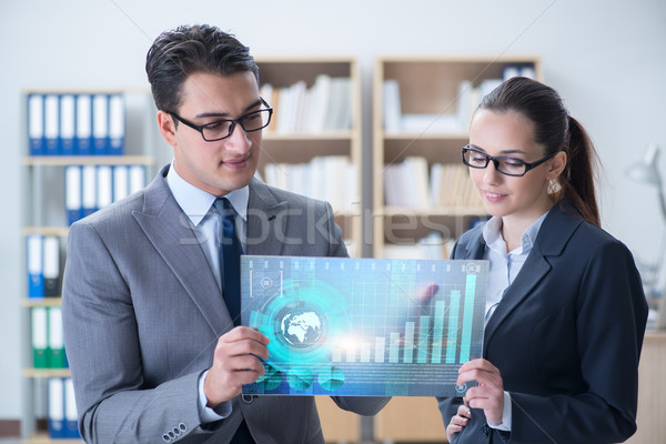 Business people discussing stock chart trends Stock photo © Elnur