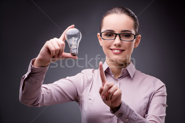 Young businesswoman in idea concept with light bulb Stock photo © Elnur